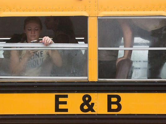 Cassie Rickrode of Delone Catholic waits out a rain delay at York College on Tuesday. The Squirettes' first-round game was postponed again to Wednesday at 4:30 p.m. at York College.
