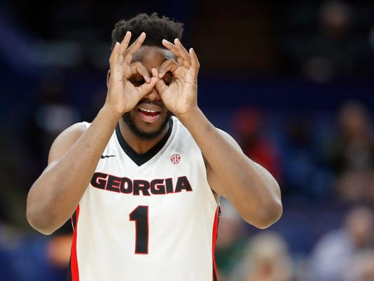 Georgia's Yante Maten celebrates after hitting a three-point basket during the first half in an NCAA college basketball game against Vanderbilt at the Southeastern Conference tournament Wednesday, March 7, 2018, in St. Louis. (AP Photo/Jeff Roberson)