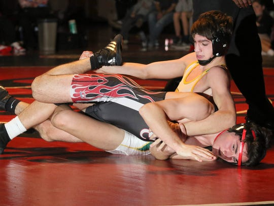 North Hunterdon's Mike Wilson (top) wrestles Hunterdon Central's Alex Kiledjian at 138 pounds on Friday, Dec. 22, 2017.