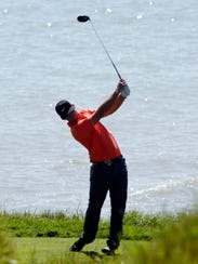 A golfer swings at Whistling Straits during the PGA