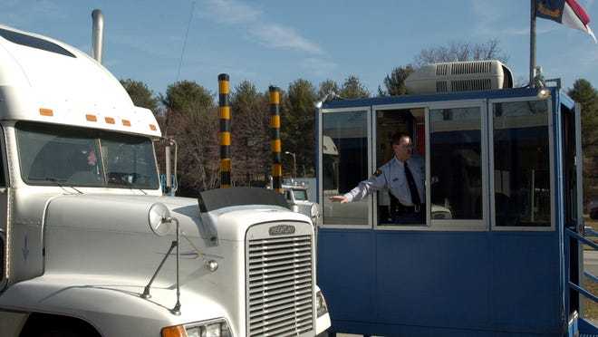 In this file photo, a state official checks a truck at the I-26 weigh station. Not all trucks have to stop at weigh stations.