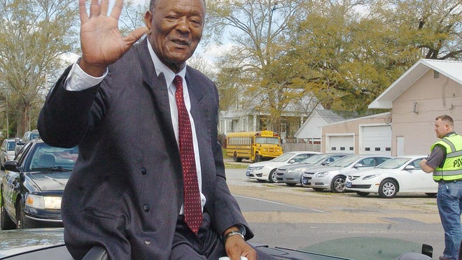 """St. Landry Parish basketball coaching legend Clarence """"Butch"""" Fontenot, shown here waving to the crowd as the grand marshal in a parade in Washington, is back on the high school basketball scene at J.S. Clark Hgh."""