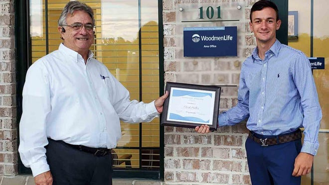 Clark Heller, a graduate of Effingham County High School, has won the WoodmenLife Chapter 1770 Scholarship. He will be attending Piedmont College in Demorest, Georgia. Bill Ross, financial representative at WoodmenLife Rincon office, presented the award.