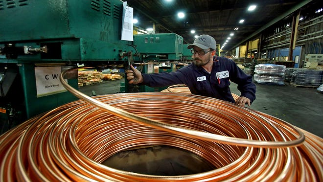 Supervisor Mark Giles oversees coils of metal at IMC-Metals America on Tuesday. The plant recently received a $360,000 grant to expand.