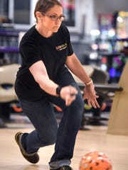Tracy George concentrates on her delivery Tuesday, May 1 at Great River Bowl.