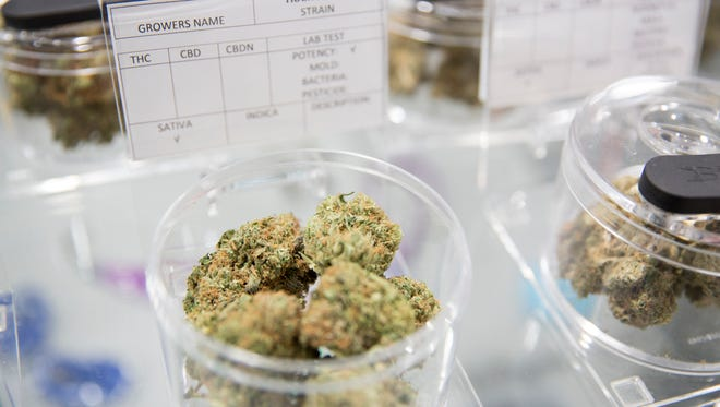 Varieties of marijuana on display in plastic canisters at a dispensary in California, which decriminalized the drug this year.