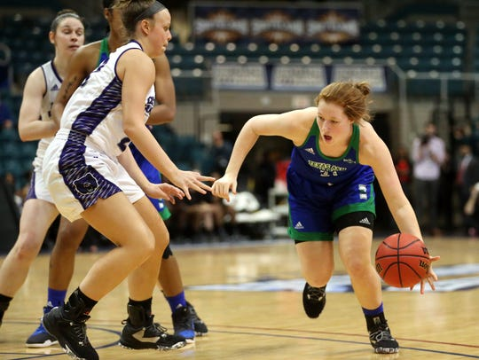 Islanders' Emma Young dribbles to the basket against