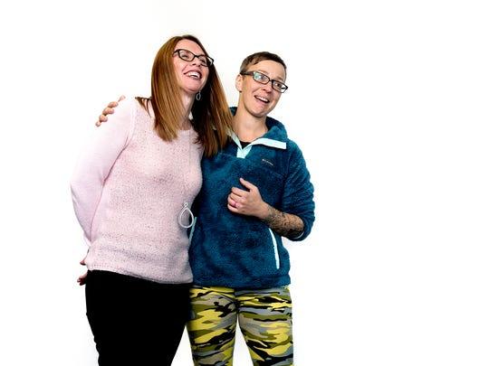 Kidney donation recipient Anna Kaschner, right, hugs