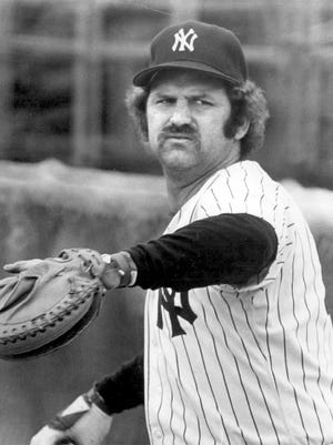 Thurman Munson warms up before a game.