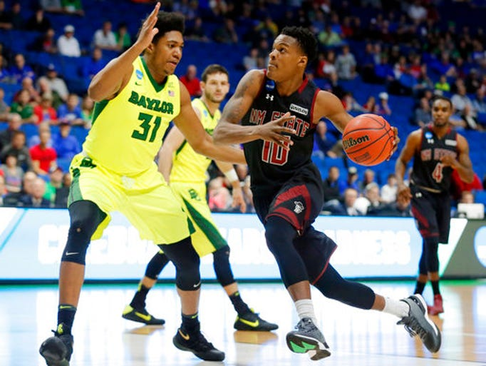 Baylor 's Terry Maston, left, defends a drive to the