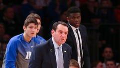 Duke Blue Devils head coach Mike Krzyzewski reacts