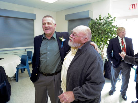 Ray Schneider, left, a former resident of the Great Falls Pre-Release Services Inc., speaks with Bob Bailey, who served as his pre-release counselor in 1997, during the 30th anniversary celebration of the center.