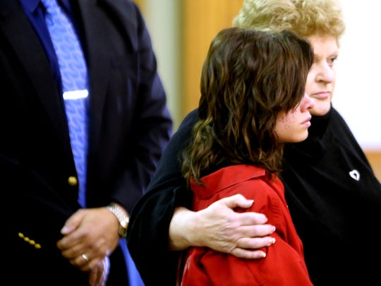 Roksana Sikorski 15, of Plymouth Township, stands with her attorney Leslie Posner before a 35th District courtroom Thursday, Oct. 23, 2014 where a $1 million bond is set.