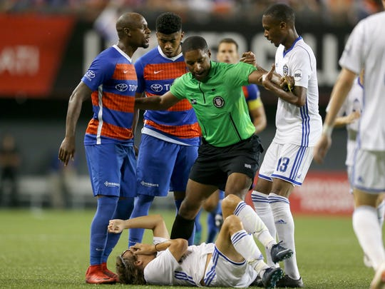 FC Cincinnati defender Justin Hoyte (32), left, argues with Charlotte Independence midfielder Kevan George (13), right, after an altercation in the second half of a USL match between Charlotte Independence and FC Cincinnati, Wednesday, July 18, 2018, at Nippert Stadium in Cincinnati. FC Cincinnati won 2-0.