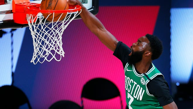 Boston Celtics' Jaylen Brown dunks against the Portland Trail Blazers during an NBA basketball game Sunday, Aug. 2, 2020, in Lake Buena Vista, Fla.