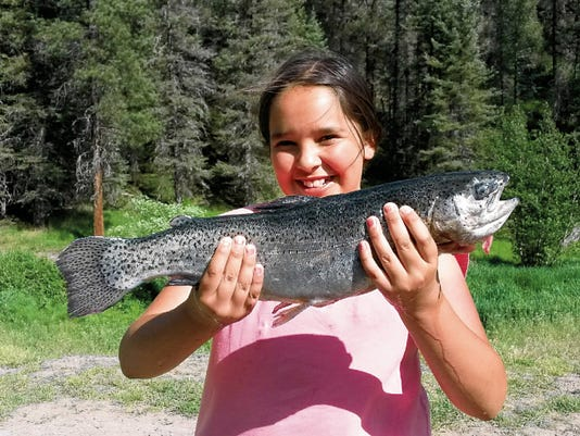 Alexa Lucero, 10, of Albuquerque, caught this 18.5-inch stocked rainbow trout at the Seven Springs Fish Hatchery brood pond June 21, using a Pistol Pete fly.