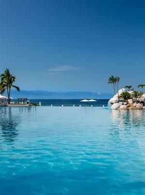 The beach-front infinity pool blends into ocean horizon at the CasaMagna Marriott Puerto Vallarta Resort & Spa.