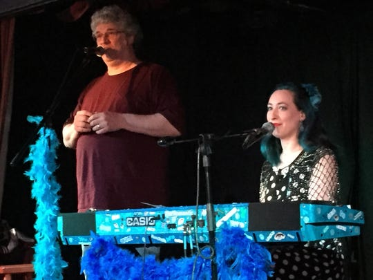Cyber Cafe West owner Jeff Kahn introduced singer/songwriter