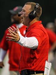 Newport head coach Matt Schmitz yells to his Wildcats