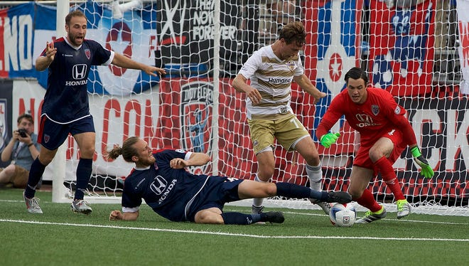 The Indy Eleven defend against Louisville City FC during U.S. Open Cup play Wednesday, June 1, 2016.