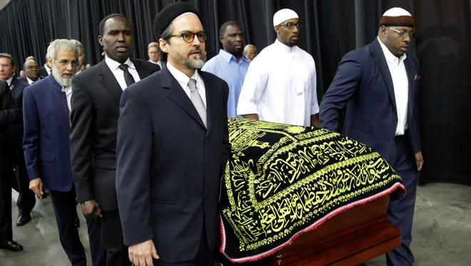 Muhammad Ali's casket is escorted by pallbearers for his Jenazah, a traditional Islamic Muslim service on Thursday at Freedom Hall in Louisville, Ky.