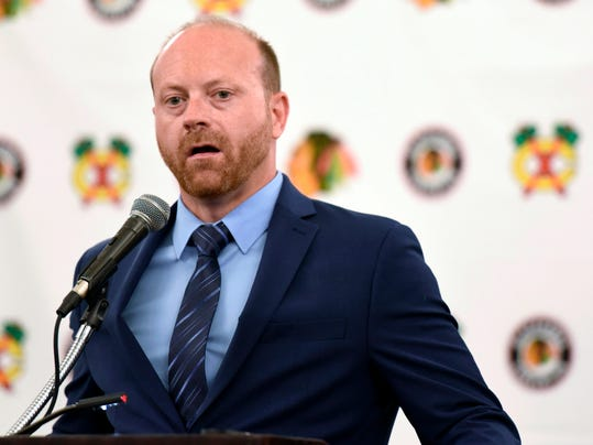 FILE - In this July 21, 2017, file photo, Chicago Blackhawks general manager Stan Bowman speaks at a news conference during the Blackhawks' NHL Convention in Chicago. Missing the Stanley Cup playoffs for the first time in 10 years does not automatically mean big roster changes, Blackhawks executives said Monday, April 9, 2018. But improvement next year is mandatory, Bowman said. (AP Photo/G-Jun Yam, File)