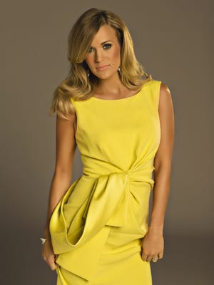 Carrie Underwood won two Teen Choice Awards on Sunday.