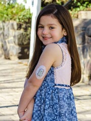 Brynn Palmer, 6, poses for a picture that shows off