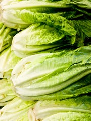 The Centers for Disease Control and Prevention expanded an E. coli warning, telling consumers not to eat whole heads and hearts of romaine lettuce from the Yuma region.