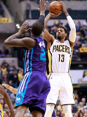 Indiana Pacers forward Paul George (13) shoots over Charlotte Hornets forward Marvin Williams during the second half of an NBA basketball game Friday in Indianapolis. Charlotte won 96-95.