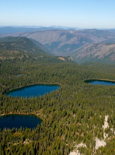 A view of the Seven Lakes Basin (though not all seven lakes) is seen from the summit of Devils Peak in the Sky Lakes Wilderness.
