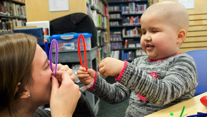 Activity projects like this one are part of the Story Hour program for young patients sponsored by the Patients' Library on the eighth floor.