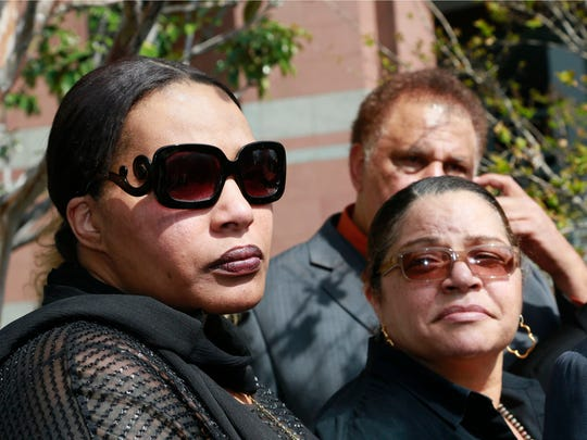 """Marvin Gaye's daughter, Nona Gaye, left, and his ex-wife, Jan Gage, take questions from the media outside Los Angeles U.S. District Court, after a jury awarded the singer's children nearly $7.4 million after determining singers Robin Thicke and Pharrell Williams copied their father's music to create """"Blurred Lines,"""" Tuesday, March 10, 2015. Nona Gaye wept as the verdict was read and was hugged by her attorney. (AP Photo/Nick Ut)"""