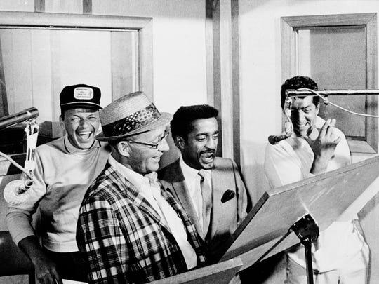 Frank Sinatra, Bing Crosby, Sammy Davis Jr. and Dean Martin, left to right, laugh during a recording session at Sinatra's Reprise Record Co. in California, Nov. 30, 1965.