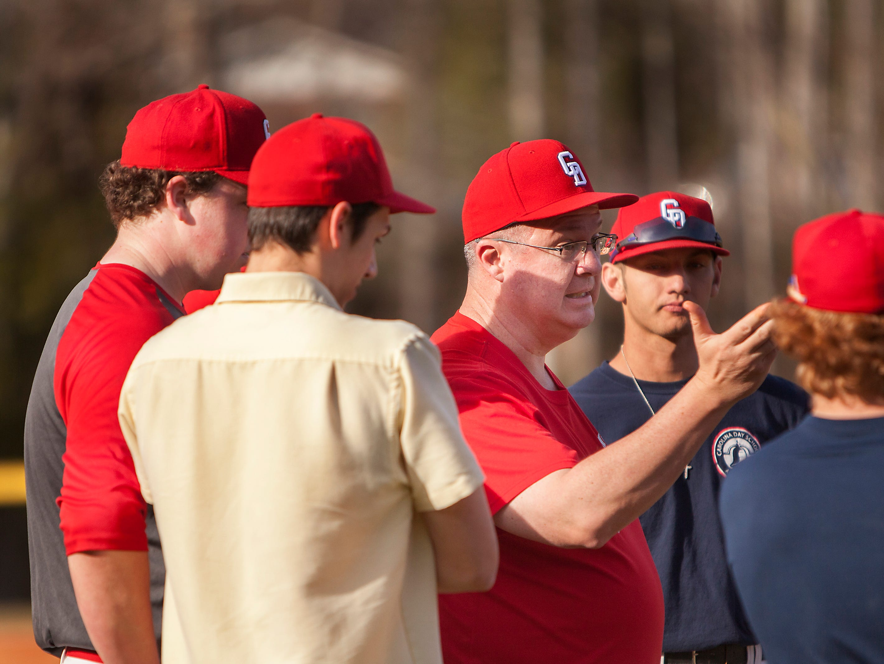 Carolina Day baseball coach Anthony Penland talks to his players during Thursday's practice.