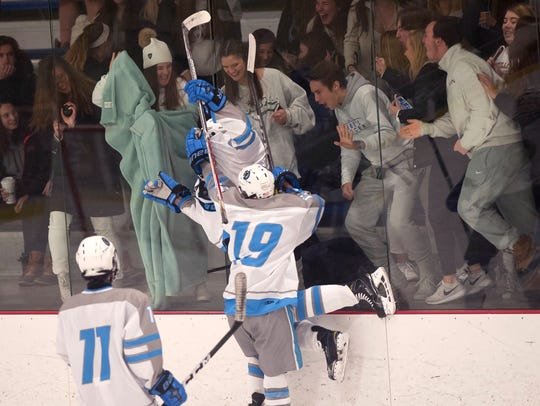 South Burlington players celebrate a goal in front