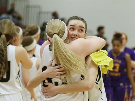 Buffalo Gap's Leah Calhoun hugs a fellow player after Gap beat Prince Edward County at the Virginia High School League Class 2 Quarterfinal game in Stuarts Draft on Friday, March 2, 2018.