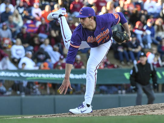Clemson junior pitcher Brooks Crawford (19) pitches to South Carolina during the top of the fourth inning on Saturday at Fluor Field in Greenville.