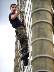 Jonathan Walberg, 14, Springfield, Va., participates in a rope climbing exercise during an eight-day Civil Air Patrol Camp at Fort Indiantown Gap this week.