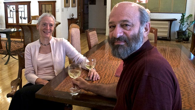 Roberta Adams and Andy Glantz relax in their Scottsdale home, where they have lived since 2002. Glantz, a professional furniture-maker, created almost all of the furniture in the house.