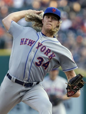 New York Mets' Noah Syndergaard pitches against the Detroit Tigers during the first inning of an interleague baseball game Friday, Aug. 5, 2016, in Detroit.