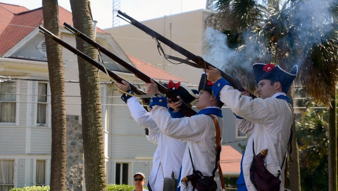 Spanish soldier reenactors fire a salute  Saturday during the Galvez Day Celebration at Fort George.