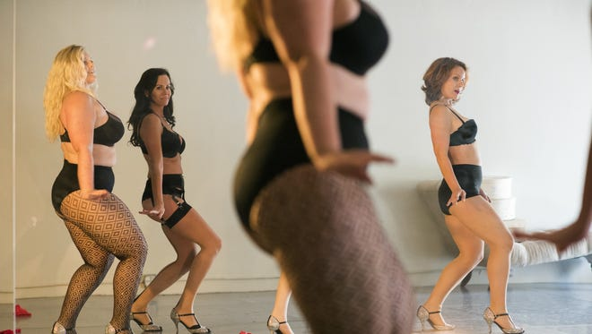 Glam! Bam! Burlesque! dancers Deanna Hunt (from left), Jeannine Stetson and Thea Mason rehearse in May.