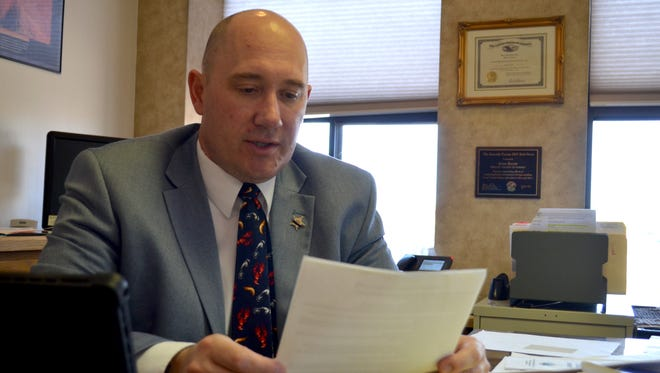 Cascade County Attorney Josh Racki reads through Marsy's Card, the new document law enforcement officers will hand to victims at the scene of a crime describing 19 new rights to be amended into the Montana Constitution.