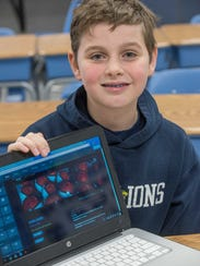 Aidan McGovern displays one of the educational video
