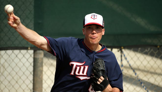 Minnesota Twins pitcher Alex Meyer delivers a throw in the bullpen during spring training baseball practice, Feb. 25, 2014, in Fort Myers, Fla.