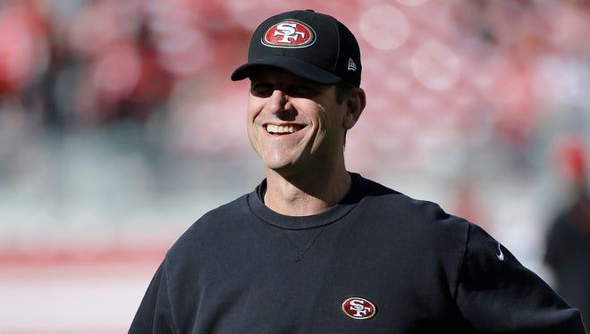 San Francisco 49ers head coach Jim Harbaugh smiles before today's game against the Arizona Cardinals in Santa Clara, Calif.