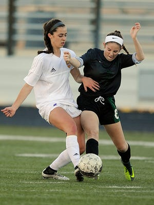 Wylie's Gracie McCaslin (4) fights for the ball with Kennedale's Cara Hunt (8) during the first half of the Lady Bulldogs' 1-0 loss on Tuesday, Jan. 31, 2017, at Wylie's Bulldog Stadium.