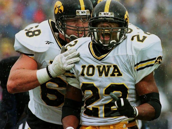 Offensive tackle Jeremy McKinney of Iowa greets Tavian