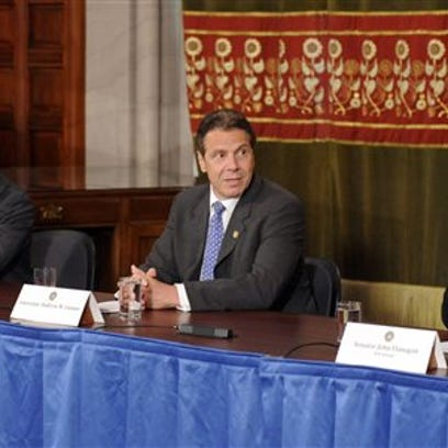 Tim Roske/AP Photo  Gov. Andrew Cuomo, center, participates in a news conference along with Assembly Speaker Carl Heastie, left, and Senate Majority Leader John Flanagan in June 2015 at the Capitol in Albany.